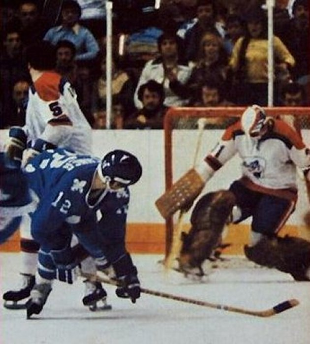 Quebec's Mike Fischner gets one in on the Racers' Michel Dion